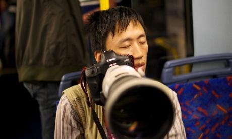 A photographer asleep on the media bus