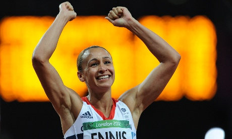 A massive smile beams over the face of Jessica Ennis as she wins gold for Britain in the women's heptathlon and celebrates after crossing the line in the final event, the 800m