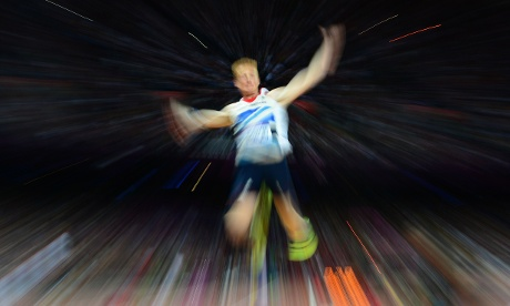 Gold medalist Britain's Greg Rutherford soars through the air during the men's long jump.