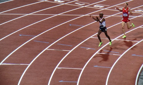Mo Farah celebrates after crossing the line to win gold in the Men's 10,000m final