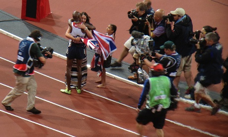 Mo Farah celebrates with his wife and child after winning gold