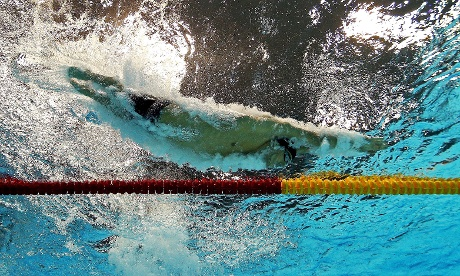 Michael Phelps of the United States dives into the pool in butterfly stage of the Men's 100m Medley Final