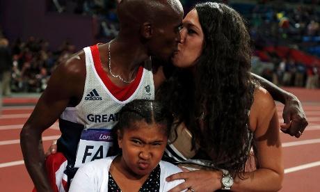 Mo Farah kisses his wife Tania