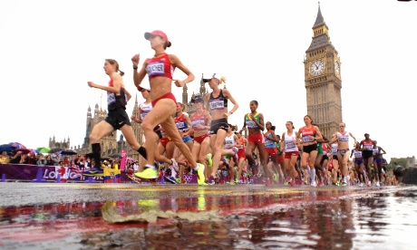 The runners in the Women's Marathon pass by the Houses of Parliament this morning