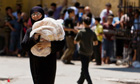 Woman carrying bread in Aleppo