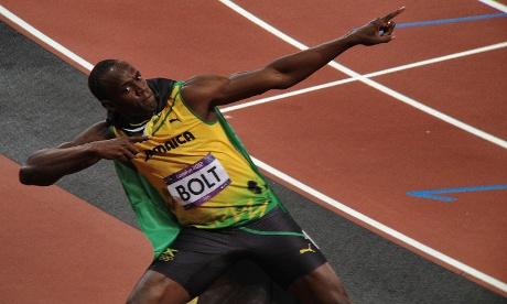 Usain Bolt celebrates winning gold in the men's 100m