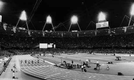 Usain Bolt crosses the line to win gold in the men's 100m