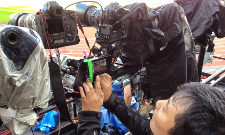 This is me setting up a remotely triggered iPhone hiding in between all the big pro cameras