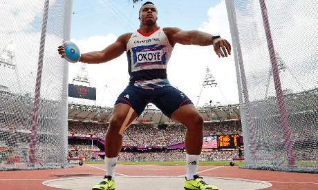 Britain's Lawrence Okoye takes a throw in a men's discus throw qualification round during the athletics in the Olympic Stadium