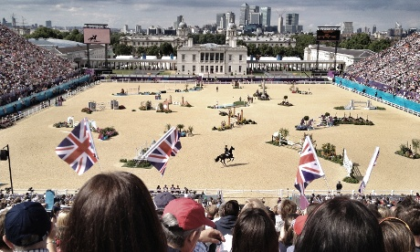 A great view over the showjumping arena towards Canary Wharf this afternoon. Photograph: Dan Chung/IPhone 4/Snapseed