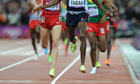 Mo Farah crosses the Olympic finish line in the men's 10,000m in his yellow-clad feet