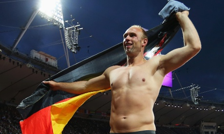 Robert Harting of Germany celebrates winning gold in the Men's Discus Throw Final on Day 11 of the London 2012 Olympic Games at Olympic Stadium