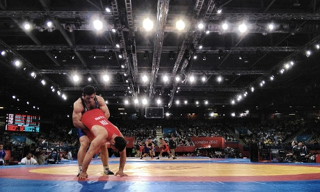 Iran's Gholamreza Ghasem Rezaei wrestles with Turkey's Cenk Ildem