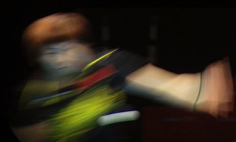 China's Li Xiaoxia, part of the gold medal winning women's table tennis team competes in the final against Japan.