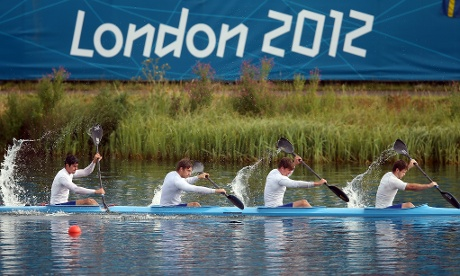 A crew warm up prior to racing in the canoe sprint on Day 12 of the Olympic Games at Eton Dorney.  Photograph: Julian Finney/Getty Images
