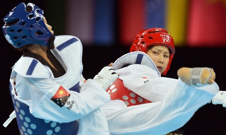 Papua New Guinea's Theresa Tona, left fights against Japan's Erika Kasahara during their women's taekwondo bout in the category under 49 kg at the ExCel centre venue. Photograph: Alberto Pizzoli/AFP/Getty Images