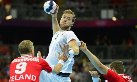 Hungary's centreback Gabor Csaszar, centre, shoots during the men's quarter-final handball match Iceland vs Hungary. Photograph: Javier Soriano/AFP/GettyImages