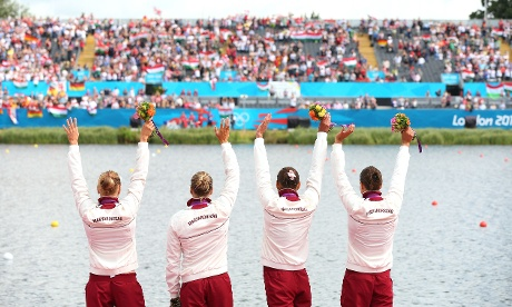Krisztina Fazekas, Katalin Kovacs, Danuta Kozak and Gabriella Szabo of Hungary celebrate on the podium after winning the Gold medal in the Women's Kayak Four 500m Sprint final. Photograph: Cameron Spencer/Getty Images