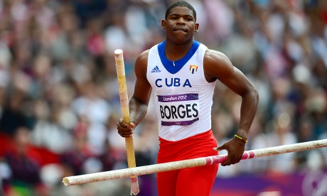 Snap it! Cuba's Lazaro Borges competes in the men's pole vault qualifications at the athletics. Photograph: Franck Fife/GettyImages