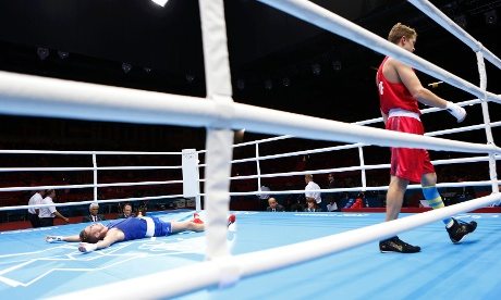 France's Alexis Vastine lays on the canvas