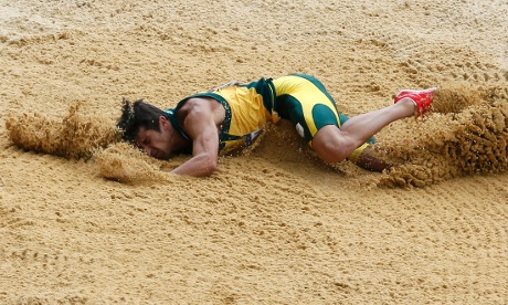 South Africa's Willem Coertzen gets a face-full of sand