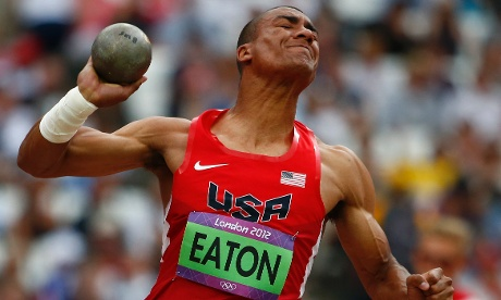 Ashton Eaton strains as he competes in the men's decathlon shot put.