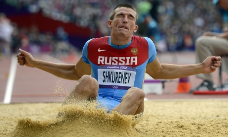 Russia's Ilya Shkurenev makes sure no sand gets in his eyes during the men's decathlon.