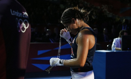 Marlen Esparza of the USA departs the ring following her loss to Cancan Ren