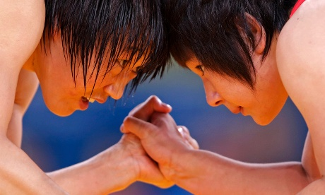 China's Ruixue Jing fights with North Korea's Un Gyong Choe on the Women's 63Kg Greco-Roman wrestling. Photograph: Toru Hanai/Reuters