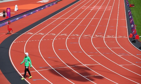 Sarah Attar of Saudi Arabia walks off the track after finishing in eighth place in her 800m heat. Photograph: Alexander Hassenstein/Getty Images