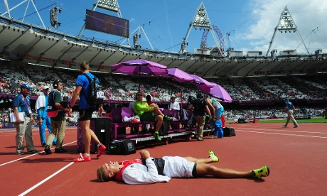 Golden sun spot: Pascal Behrenbruch of Germany lies onthe ground in the sun after competing in the Men's Decathlon Shot Put. Photograph: Stu Forster/Getty Images
