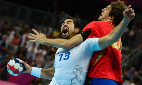 France's Nikola Karabatic vies with Spain's Viran Morros de Argila during the men's quarter-final handball. Photograph: Javier Soriano/Getty Images