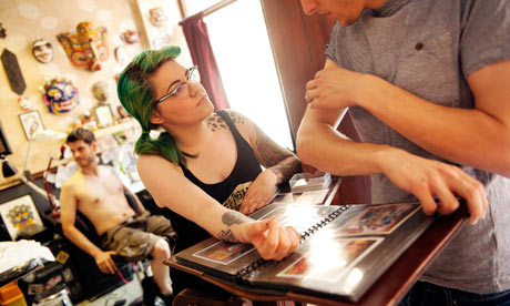 customer asks about designs at King's Cross Tattoo Parlour, London ...