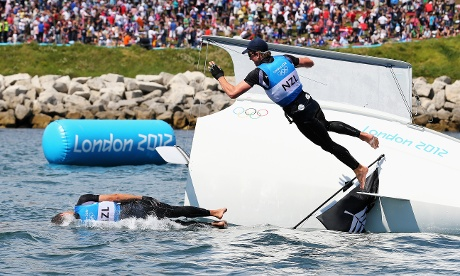 Peter Burling and Blair Tuke of New Zealand celebrate winning silver in the Men's 49er Sailing