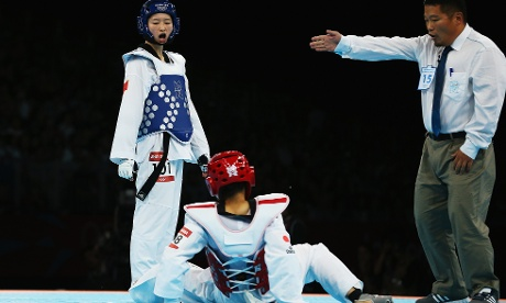 Erika Kasahara of Japan competes against Jingyu Wu of China during the Women's -49kg quarterfinal Taekwondo match. Photograph: Hannah Johnston/Getty Images