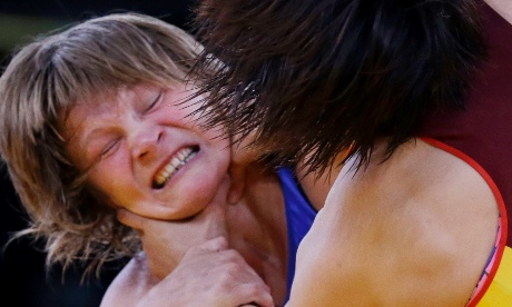 Is that allowed? Lubov Volosova of Russia, left, and Jing Ruixue of China, compete in 63-kg women's freestyle wrestling. Photograph: Paul Sancya/AP