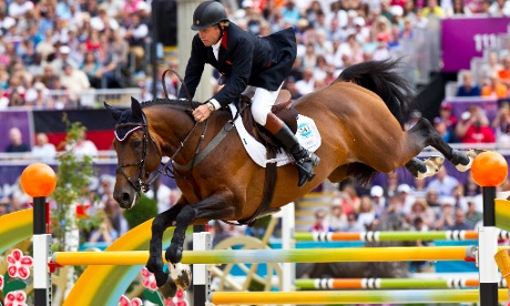 Nick Skelton of Team GB jumping with his horse Big Star during the Final Round B of the Jumping Individual Equestrian Comeptition. Skelton finished outside the medal places. Photograph: Antonio Olmos for the Guardian