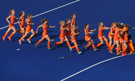 Players of the Netherlands celebrate after Ellen Hoog scored the winning penalty in the shoot-out after extra time during the women's hockey semi-final match against New Zealand. Photograph: Daniel Berehulak/Getty Images