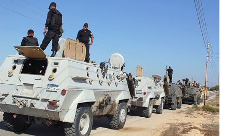 Egyptian security forces stand by in preparation for a military operation in the northern Sinai peninsula on August 8, 2012.