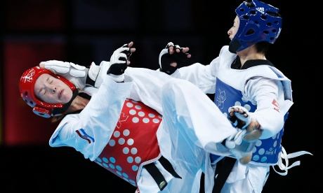 Take that: Jingyu Wu of China lands a kick to the head of Croatia's Lucija Zaninovic during the 49kg semi-final.