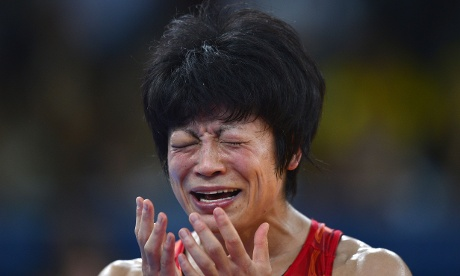 Japan's Hitomi Obara cries after she beat Azerbaijan's Mariya Stadnyk in the Women's wrestling 48kg Freestyle final.