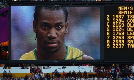 A giant screen shows a focused Yohan Blake ahead of his victory in his men's 200m semi-final.
