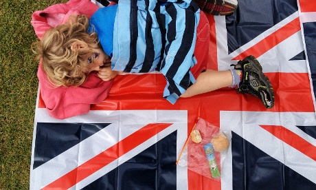 Another young spectator would rather sleep than watch the athletics than the TV screens in the Olympic park