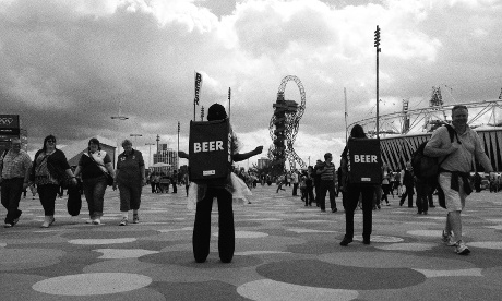 Beer sellers in the Olympic Park looking a bit like astronauts headed back to mission control.