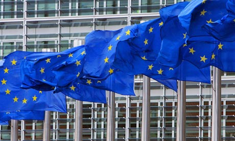 EU flags are seen out outside European Commission headquarters in Brussels
