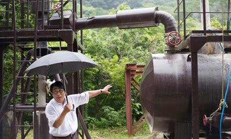 Kazuya Ikeda explains the future location and logistics of a geothermal plant in Fukushima, Japan