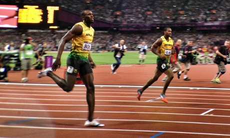 Usain Bolt kisses the ground after winning gold in the men's 200m final