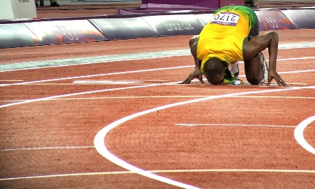 Usain Bolt kisses the ground after winning gold in the men's 200m final.