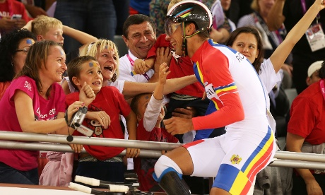 Carol-Eduard Novak of Romania celebrates winning his gold in Men's Individual C4 Pursuit Final with the crowd.