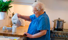Independent elderly lady making a cup of tea 